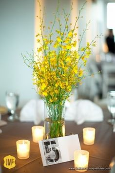 Bright Yellow Oncidium Orchid Centerpiece with Candles - The French Bouquet - Josh McCullock Photography