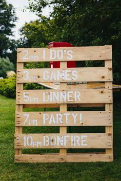 Wooden Pallet Order of The Day Sign | Outdoor Humanist Ceremony | Festival Wedding | Rustic Tipi Reception | Talton Lodge | Bouncy Castle | John Hope Photography | http://www.rockmywedding.co.uk/nicola-alex/