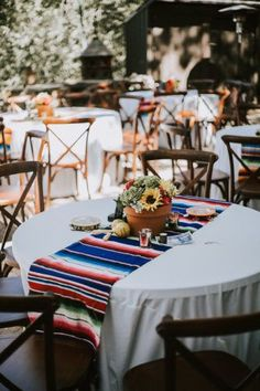 Festive reception details of Mexican blankets, sunflowers, DIY centerpieces, and musical instruments. Sacred Mountain J. Mexican Wedding Decorations, Mexican Themed Weddings, Quince Decorations, Mexican Wedding Reception, Mexican Wedding Traditions, Birthday Decorations, Mexican Fiesta Birthday Party, Fiesta Theme Party, Quinceanera Centerpieces