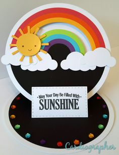 Make the base dark blue instead of black.Sunshine and rainbows penny slider/easel card - Slider cards are super hot right now and nothing could be cuter than this sun sliding along a rainbow! Fancy Fold Cards, Folded Cards, Kids Cards, Baby Cards, Scrapbook Cards, Scrapbooking, Spinner Card, Rainbow Card, Slider Cards
