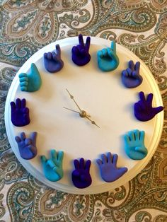 Hand Sculpted American Sign Language Clock is a unique piece of wall art that looks wonderful in a childs room or nursery, and even in a classroom or home office. COLORS: Hands are made to order and you choose the color of each one! See the color chart image to help you decide your color preference. Up to 12 different colors can be chosen (one per hand). *Colors may slightly vary from picture due to the different computer monitor settings.  CLOCK BASE: You can also choose between a natural…