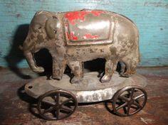 tin elephant on wheels