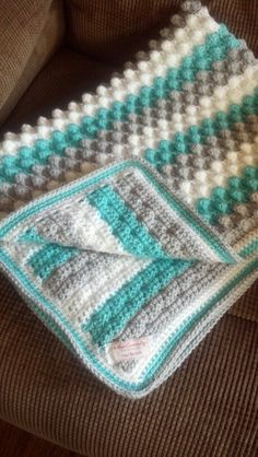 I love the colors I used for this baby blanket. Bubble stitch. With single crochet border.