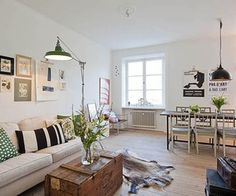 Charming and Elegant Swedish Flat    This attractive and extremely stylish flat is located in Östermalm, a suburb of Stockholm, Sweden. Just recently renovated, this charming humble abode is comprised of 635 square feet. Upon entrance to the inviting home, the living room opens up to greet you with an open connection to the lovely new full equipped kitchen in classic 20th century style with a spacious dining area.