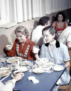 Grace Kelly eating with   Ann Blyth and Janet Leigh in   MGM canteen c. 1954. Elizabeth Taylor and Stewart Granger are at the table behind them. Photo by Gene Lester