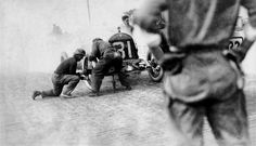 Louis Disbrow gets a wheel change at the 1913 Indy 500.  From the Ivan P Wheaton collection.