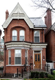 This bay and gable Victorian house is located at 24 Hazelton Avenue in the neighborhood of Yorkville, Toronto.