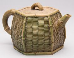 CHINESE YIXING ZISHA CLAY ARTISTIC LIGHT-BROWN TEAPOT AND COVER,