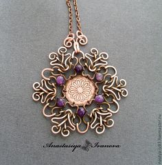 Beautiful and intricate wire wrapped pendant. I love her work.