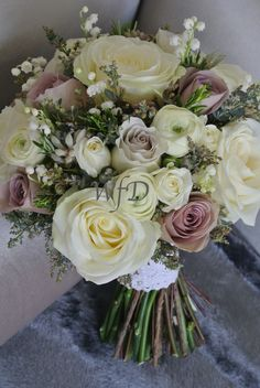 Vintage brides bouquet including Lily of the Valley. Avalanche Roses, Rosemary, Amnesia Roses.
