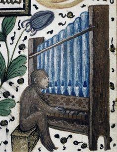 'Organ-playing monkey' margin illumination from a Medieval manuscript