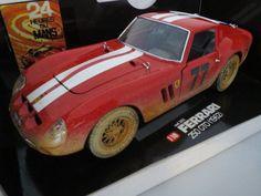 RAR: Maranello Cars Umbau Ferrari 250 GTO (1962) Schmutzversion, Ferrari 250 GTO (1962) Schmutzversion  Umbau auf Basis Bburago   Rennversion Schmutzversion  Rennbeklebung Startnummer #77   Lenkung funktionstüchtig alles zum öffnen   Maßstab: 1:18  Farbe: rot  Hersteller: Maranello Cars Umbau Bburago