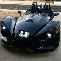 Polaris Slingshot...these 3 wheelers are so cool! I sat in one before and it was awesome!!! Just like a car!