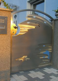 Stainless Steel Abstract Wave Gate in Sunset Glow