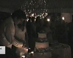 jfk jr with his wife Carolyn at their wedding reception. JFK JR is cutting a piece of their wedding cake