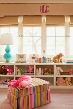 lots of color &  shelving... love the cornice box monogram