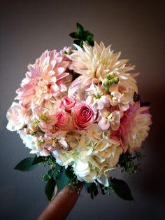 Blush and peach bridesmaid bouquet featuring dahlias