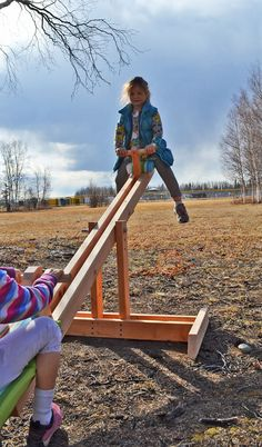 DIY Seesaw.  Yeah, like Grandpa needs another project...... This is the next thing on G'pas to do list..... Now I gotta find a DIY merry go round!!!!