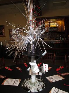 Silent Auction Magic Theme Party Centerpiece Made by me for St. Clare's Silent Auction in Rancho Cucamonga Ca Playing Card is used as the Table Number