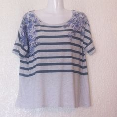 "ANTHRO ""Pilcro & The Letterpress"" Flower Striped Pima cotton/modal blend. Light gray background and navy blue stripes with lavender color flowers. Kinda boxy, so I would say its oversized. Anthropologie Tops Tees - Short Sleeve"