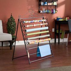 Take a look at this Southern Enterprises Easel/Wall Mount Craft Storage Rack by Craft Room Storage (Perfect for wrapping presents and then blanket storage the rest of the time.