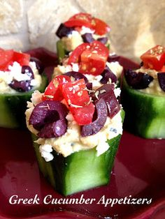 Cucumbers stuffed with hummus, feta cheese, olives, and cherry tomatoes sprinkled with oregano