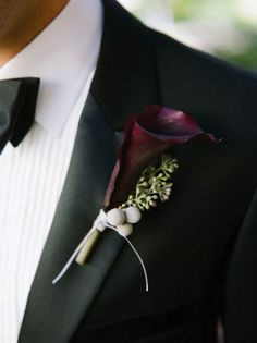 The rest of the boutonnieres will be dark purple calla lilies and green leaves wrapped in green ribbon with the stems showing.