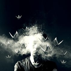 Ingredients: origami cranes, wires, smoke machine, powder, strobes. by John Alunan, via Flickr