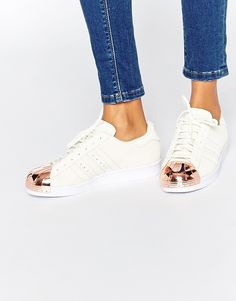 Adidas Superstar 80s rose gold metal toe cap sneakers are fresh, clean, and add a nice touch of shine to your outfit.