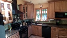 A beautiful traditional kitchen with maple kitchen cabinets from CliqStudios.com and dark granite counters.