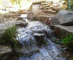 pondless waterfalls are great fall winter projects, landscape, outdoor living, ponds water features, This Pondless Waterfall is the focal point from an indoor room What a wonderful view
