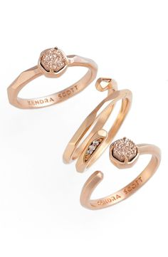 A mix of drusy stones and sparkling cubic zirconias accent the rose gold bands of three slender rings that playfully stack and layer with one another.