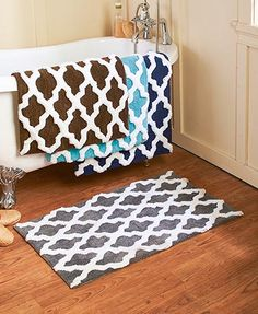 "Experience incredible comfort underfoot with this Oversized Lattice Bath Rug. Made from durable polyester microfiber, it features a lattice pattern that coordinates well with contemporary decor. 21"" x 34"". Machine care. Imported."