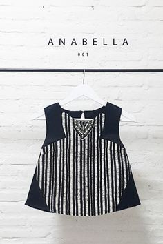 Batik Stripe Combination Design with Pearl Embellishment on V-Shaped Jewel Blouse  Length of Blouse: 47 cm  Material Used : Batik Stripe Design, Cotton. Pearl Embellishment. Thick Satin.  Button at the back