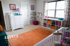 "Cheerful nursery with orange and purple accents - love the whimsical ""monster"" accents!"