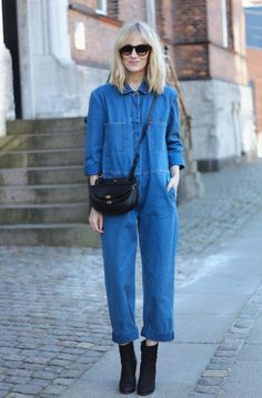 denim jumpsuit with boots and saddle bag