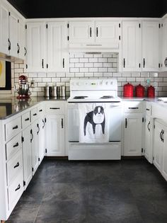 Love this kitchen inspiration - white cabinets & black hardware - the floors are awesome too!  (At Home With Stacie Bloomfield)