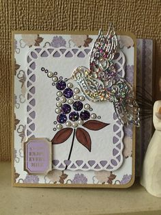 Tattered lace humming bird and Woodware bubble stamp.