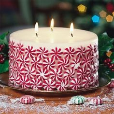 Christmas candles  Glue peppermint candy to a white candle - the best is to use a candle that has a warm vanilla scent, or cake batter, and mixed with the peppermint it is sublime!