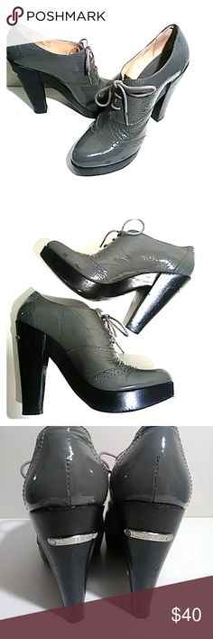 """Michael Kors Gray leather lace up heels Very nice patent leather gray heels in good condition, 5"""" wooden heels. Shoes show some wear as seen in pictures. MICHAEL Michael Kors Shoes Flats & Loafers"""
