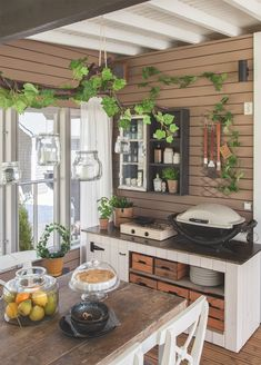 Beautiful Outdoor Kitchen Ideas For Summer Kitchen Designs Nowadays, the easiest way to decorate a summer kitchen is with furniture. It is true that this is the place where the family will spend most of their . Cottage Design, Cottage Style, Used Cardboard Boxes, Top Of Cabinets, Low Chair, Relaxing Places, Summer Kitchen, Backyard Projects, Kitchen Decor