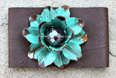 Use the discount code GUGREPKCAR for 10% off your entire order at www.gugonline.com! Leather Bracelet with Metal Flower in Turquoise with Crystal