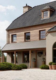 wel: de overkapping, verschillende materialen: onderaan wit, bovenaan hout niet: het dak, de dakkapel Mi Casa