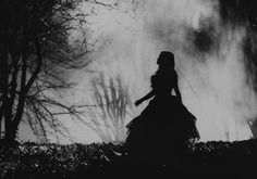 victorian silhouette in foggy woods: photographer unknown, not credited in source, not identifiable in tineye search