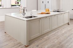 This stunning kitchen belongs to one of our lovely customers! The vast kitchen island unit uses frontals painted in Farrow & Ball's Hardwick White, which look splendid with white walls and worktops. http://www.solidwoodkitchencabinets.co.uk