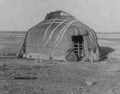 A Kyrgyz Yurt on the Golodnaya Steppe, photographed by Sergey Prokudin-Gorskiy around 1910.  The roof felts cover the reed screen walls and are held in position by criss-crossed narrow white tent bands.