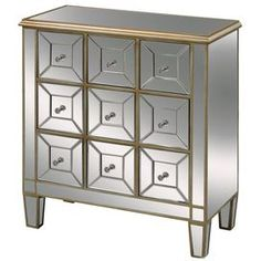 "Apothecary-style chest with mirrored facings and golden trim.Product: Chest    Construction Material: MDF and glass    Color: Gold   Features:Apothecary-inspired silhouetteMirrored    Dimensions: 34"" H x 31"" W x 15"" D"