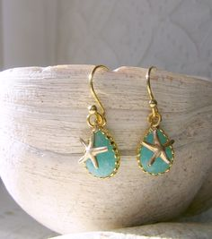 Stunning Mint blue cracked glass delicate tear drop gemstone earrings with14k gold filled starfish dangling from 22k gold plated ear wires. Any time gifts for her. Moms, sisters, friends will love these. Beach Wedding, bridesmaid gift. Have a look at my beautiful aqua, aquamarine and blue glass gemstones. I can make these for you in other color glass gemstones, just send me a message! December Birthstone  GEMSTONES - aqua, aquamarine, cracked aquamarine, erinite, blue mint, mint blue, alice…