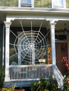 DIY spider web made out of rope. Blog post full of outdoor Halloween decorating ideas!
