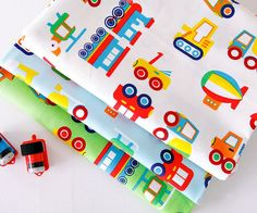 Hey, I found this really awesome Etsy listing at https://www.etsy.com/listing/193992140/toy-cars-pattern-cotton-fabric-by-yard-3